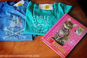 cat t-shirts and a cat book